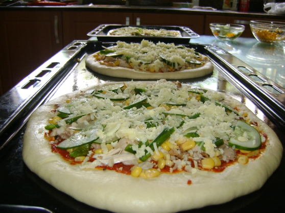 Lastly topping with Mozzarella cheese and assembly of the three pizzas